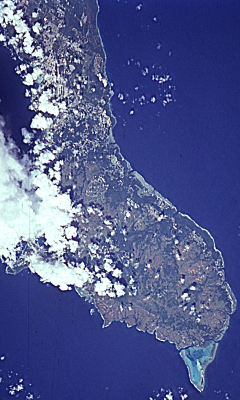 "9. Guahan (United States Territory of Guam). Earth Sciences and Image Analysis, NASA-Johnson Space Center. 8 December 2003. ""Astronaut Photography of Earth - Quick View."" <http://eol.jsc.nasa.gov/scripts/sseop/QuickView.pl?directory=ESC&ID=STS068-258-55>; National Aeronautics and Space Administration (NASA, http://www.nasa.gov), Government of the United States of America (USA)."