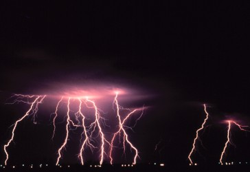 1. Multiple cloud-to-ground lightning strokes during a night-time thunderstorm, March, 1978. Norman, State of Oklahoma, USA. Photo Credit: C. Clark, OAR/ERL/National Severe Storms Laboratory (NSSL), National Oceanic and Atmospheric Administration Photo Library (http://www.photolib.noaa.gov), National Severe Storms Laboratory (NSSL) Collection, National Oceanic and Atmospheric Administration (NOAA, http://www.noaa.gov), United States Department of Commerce (http://www.commerce.gov), Government of the United States of America (USA).