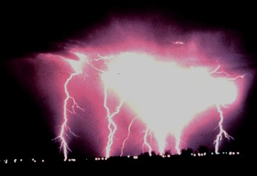 2. Intense cloud-to-ground lightning during a night-time thunderstorm, March, 1978. Norman, State of Oklahoma, USA. Photo Credit: C. Clark, OAR/ERL/National Severe Storms Laboratory (NSSL), National Oceanic and Atmospheric Administration Photo Library (http://www.photolib.noaa.gov), National Severe Storms Laboratory (NSSL) Collection, National Oceanic and Atmospheric Administration (NOAA, http://www.noaa.gov), United States Department of Commerce (http://www.commerce.gov), Government of the United States of America (USA).
