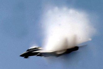 6. An F-14 Tomcat Fighter Jet From the Carrier Air Wing 8, 'Black Lions' VFA-213, United States Navy, Mediterranean Sea. Reaching the sound barrier, breaking the sound barrier: Flying at transonic speeds (flying transonically) -- speeds varying near and at the speed of sound (supersonic) -- can generate impressive condensation clouds caused by the Prandtl-Glauert Singularity. For a scientific explanation, see Professor M. S. Cramer's Gallery of Fluid Mechanics, Prandtl-Glauert Singularity at <http://www.GalleryOfFluidMechanics.com/conden/pg_sing.htm>; and Foundations of Fluid Mechanics, Navier-Stokes Equations Potential Flows: Prandtl-Glauert Similarity Laws at <http://www.Navier-Stokes.net/nspfsim.htm>. Photo Credit: Photo Credit: Photographer's Mate Airman Michael McCannCole, United States Navy; Defense Visual Information (DVI, http://www.DefenseImagery.mil, 030506-N-WX450-508) and United States Navy (USN, http://www.navy.mil), United States Department of Defense (DoD, http://www.DefenseLink.mil or http://www.dod.gov), Government of the United States of America (USA).