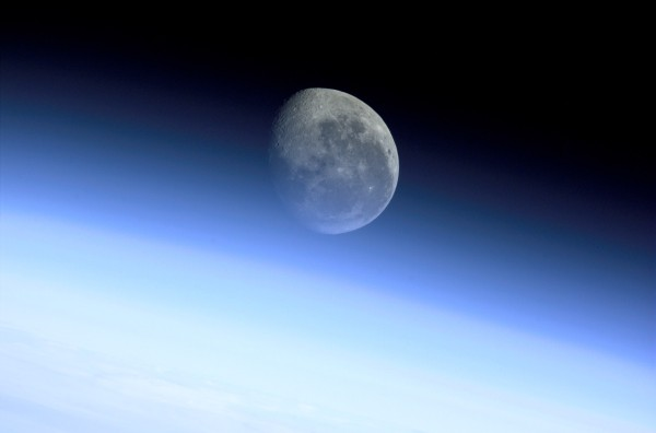 """Earth (bottom), its Luminous Blue Protective Envelope of Gases Known as the Limb (middle), and the Moon (at top, center). Photo Credit: Atmospheric Limb, Moon, Earth. Sciences and Image Analysis, NASA-Johnson Space Center. 8 December 2003. """"Astronaut Photography of Earth - Quick View."""" <http://eol.jsc.nasa.gov/scripts/sseop/QuickView.pl?directory=ESC&ID=ISS002-E-9767>; National Aeronautics and Space Administration (NASA, http://www.nasa.gov), Government of the United States of America (USA)."""