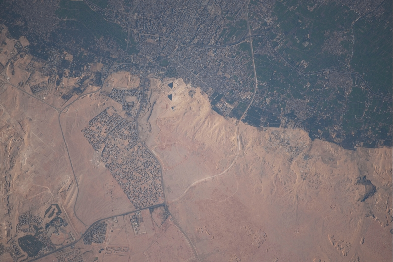 12. El Giza, The Great Pyramids and Cairo, January 24, 2010 at 08:09:12 GMT, Jumhuriyat Misr al-Arabiyah - Arab Republic of Egypt, As Seen From the International Space Station (Expedition Twenty-Two), Latitude (LAT): 30.6, Longitude (LON): 31.3, Altitude (ALT): 182 Nautical Miles, Sun Azimuth (AZI): 147 degrees, Sun Elevation Angle (ELEV): 33 degrees. Photo Credit: NASA; ISS022-E-36022, El Giza, The Great Pyramids, Cairo, International Space Station (Expedition Twenty-Two); Image Science and Analysis Laboratory, NASA-Johnson Space Center. 'Astronaut Photography of Earth - Display Record.' <http://eol.jsc.nasa.gov/scripts/sseop/photo.pl?mission=ISS022&roll=E&frame=36022>; National Aeronautics and Space Administration (NASA, http://www.nasa.gov), Government of the United States of America (USA).