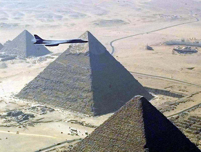 "1. Aerial View of the Pyramids and a United States Air Force (USAF) B-1B Lancer Bomber, 1999, Jumhuriyat Misr al-Arabiyah - Arab Republic of Egypt (Egypt). Photo Credit: Air Force Link - Photos (http://www.af.mil/photos, 021105-O-9999G-017, ""Flying over foreign lands""), United States Air Force (USAF, http://www.af.mil), United States Department of Defense (DoD, http://www.DefenseLink.mil or http://www.dod.gov), Government of the United States of America (USA)."