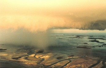 1. A Huge Thunderstorm Cloud is Partitioned: To the Left, A Rain Shaft -- To the Right, A Rainfree Base, August 1993. Key West, State of Florida, USA. Photo Credit: Lieutenant Debora Barr, NOAA Corps, National Oceanic and Atmospheric Administration Photo Library (http://www.photolib.noaa.gov), Historic NWS (National Weather Service) Collection, National Oceanic and Atmospheric Administration (NOAA, http://www.noaa.gov), United States Department of Commerce (http://www.commerce.gov), Government of the United States of America (USA).