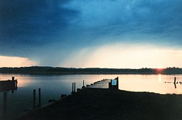 3. A Small Rain Storm and Sunset Across the Patuxent River, April 1992. State of Maryland, USA. Photo Credit: Mary Hollinger, NODC Biologist, NOAA, National Oceanic and Atmospheric Administration Photo Library (http://www.photolib.noaa.gov), America's Coastlines Collection, National Oceanic and Atmospheric Administration (NOAA, http://www.noaa.gov), United States Department of Commerce (http://www.commerce.gov), Government of the United States of America (USA).