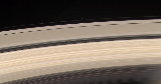 Saturn's Rings and F-Ring Shepherd Moons (Shepherding Moons) Prometheus (at left, inside the F-Ring) and Pandora (middle, outside the F-Ring), and Janus (right, top). Photo Credit: Cassini-Huygens Mission (http://saturn.jpl.nasa.gov), Cassini Orbiter, June 18, 2004; National Aeronautics and Space Administration (NASA, http://www.nasa.gov)/Jet Propulsion Laboratory (JPL, http://www.jpl.nasa.gov), Government of the United States of America (USA).