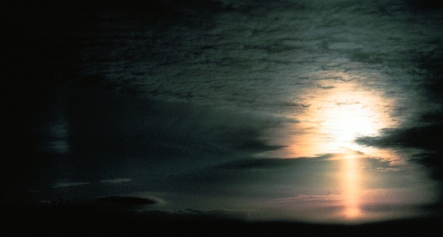 One Hour Before Sunset: Total Darkness at Left, On the Right a Sun Pillar (below the Sun) and a Sun Dog (left of the Sun). View to Southwest (SW) From Flat Top Mountain, State of North Carolina, USA. Photo Credit: Grant W. Goodge, National Oceanic and Atmospheric Administration Photo Library (http://www.photolib.noaa.gov), Historic NWS (National Weather Service) Collection, National Oceanic and Atmospheric Administration (NOAA, http://www.noaa.gov), United States Department of Commerce (http://www.commerce.gov), Government of the United States of America (USA).