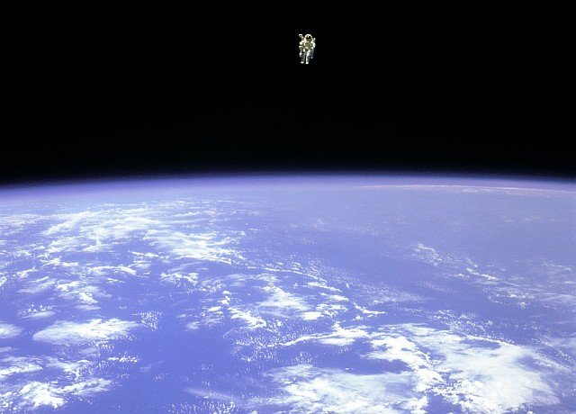 Mission Specialist Bruce McCandless II, is seen further away from the confines and safety of his ship than any previous astronaut has ever been. This space first was made possible by the Manned Manuevering Unit or MMU, a nitrogen jet propelled backpack. After a series of test maneuvers inside and above Space Shuttle Challenger's payload bay, McCandless went 'free-flying' to a distance of 320 feet away from the Orbiter. This stunning orbital panorama view shows McCandless out there amongst the black and blue of Earth and space. Photo Credit: 'EVAtion', Extravehicular Activity (EVA) Spacewalk, February 12, 1984, Space Shuttle Challenger, STS-41B, GRIN (http://grin.hq.nasa.gov) Database Number: GPN-2000-001087, National Aeronautics and Space Administration (NASA, http://www.nasa.gov), Government of the United States of America.