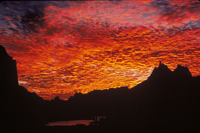 """Clouds Painted in Shades of Red Give the Appearance of """"Night Fires"""" in the Sky. Photo Credit: Richard Johnson, Washington DC Library, United States Fish and Wildlife Service Digital Library System (http://images.fws.gov, WO-3149-CD-43A), United States Fish and Wildlife Service (FWS, http://www.fws.gov), United States Department of the Interior (http://www.doi.gov), Government of the United States of America (USA)."""