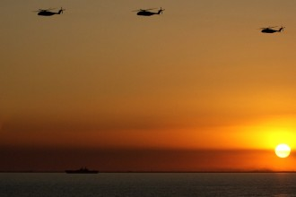2. Sunset at the Northern Arabian Gulf. Photo Credit: Petty Officer Tom Sperduto of the United States Coast Guard (http://www.uscg.mil), Navy NewsStand - Eye on the Fleet Photo Gallery (http://www.news.navy.mil/view_photos.asp, 030302-C-9409S-009), United States Navy (USN, http://www.navy.mil), United States Department of Defense (DoD, http://www.DefenseLink.mil or http://www.dod.gov), Government of the United States of America (USA).