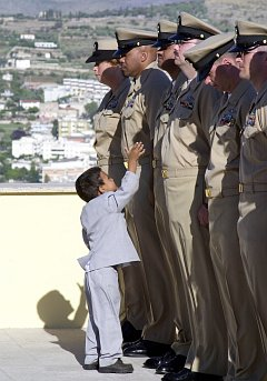 2. An eager little boy breaks from the gathered crowd to congratulate his father, a newly frocked chief petty officer, September 16, 2003. Naval Support Activity Gaeta, Repubblica Italiana - Italian Republic (Italy). Photo Credit: Photographer's Mate 1st Class Paul J. Phelps, Navy NewsStand - Eye on the Fleet Photo Gallery (http://www.news.navy.mil/view_photos.asp, 030916-N-2716P-120), United States Navy (USN, http://www.navy.mil), United States Department of Defense (DoD, http://www.DefenseLink.mil or http://www.dod.gov), Government of the United States of America (USA).