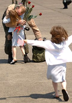 3. Two very happy little girls greeting their father, May 1, 2003. Naval Air Facility Atsugi, Nippon-koku (Nihon-koku) - Japan. Photo Credit: Photographer's Mate 2nd Class Michael A. Damron, Navy NewsStand - Eye on the Fleet Photo Gallery (http://www.news.navy.mil/view_photos.asp, 030501-N-0252D-001), United States Navy (USN, http://www.navy.mil), United States Department of Defense (DoD, http://www.DefenseLink.mil or http://www.dod.gov), Government of the United States of America (USA).