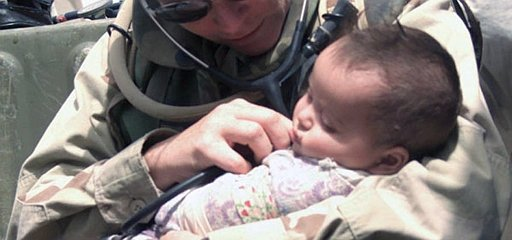 4. Securely and comfortably nestled in the arm of Hospital Corpsman 1st Class Maureen Smith, a cute and calm Iraqi baby is examined during a humanitarian visit to an Iraqi village, April 8, 2003. Al Jumhuriyah al Iraqiyah - Republic of Iraq. Photo Credit: Lance Cpl. Alicia M. Anderson of the United States Marine Corps (http://www.usmc.mil), Navy NewsStand - Eye on the Fleet Photo Gallery (http://www.news.navy.mil/view_photos.asp, 030408-M-5607A-013), United States Navy (USN, http://www.navy.mil), United States Department of Defense (DoD, http://www.DefenseLink.mil or http://www.dod.gov), Government of the United States of America (USA).
