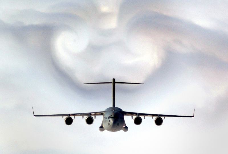 "The United States Air Force C-17 Globemaster III Military Transport Parts the Western South Carolina Clouds Causing an Impressive Corridor-in-the-Clouds and Cloud Formations, February 2, 2003. State of South Carolina, USA. Photo Credit: Staff Sgt. D. Myles Cullen, 1st Combat Camera Squadron, Air Force Link - Photos (http://www.af.mil/photos, 030202-F-0193C-004, ""Parting clouds""), United States Air Force (USAF, http://www.af.mil), United States Department of Defense (DoD, http://www.DefenseLink.mil or http://www.dod.gov), Government of the United States of America (USA). C-17 Globemaster III fact sheets from the United States Air Force <http://www.af.mil/factsheets/factsheet.asp?fsID=86> and The Boeing Company <http://www.boeing.com/defense-space/military/c17/index.htm>."