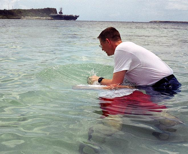 Baptism by Immersion in the Flowing Waters of the Philippine Sea on Easter Sunday, April 20, 2003. Apra Harbor, Territory of Guam, USA. Photo Credit: Lt. Cmdr. Bob Meeker, Navy NewsStand - Eye on the Fleet Photo Gallery (http://www.news.navy.mil/view_photos.asp, 030420-N-9236M-025), United States Navy (USN, http://www.navy.mil), United States Department of Defense (DoD, http://www.DefenseLink.mil or http://www.dod.gov), Government of the United States of America (USA).