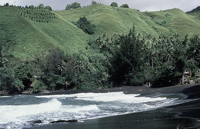 The Beautiful Green Hills and the Black Lava Sand Beach of Tahiti, Territoire de la Polynesie Francaise - Territory of French Polynesia. Photo Credit: Quartermaster Joseph Schebal, NOAA, National Oceanic and Atmospheric Administration Photo Library (http://www.photolib.noaa.gov, theb3089), Historic C&GS Collection, National Oceanic and Atmospheric Administration (NOAA, http://www.noaa.gov), United States Department of Commerce (http://www.commerce.gov), Government of the United States of America (USA).