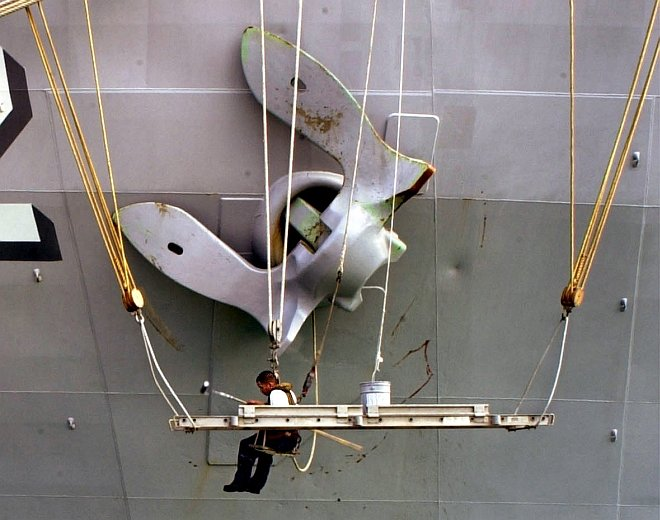 While at Sea and Suspended in the Air, Painting and Preservation of the Ship's Massive 30,000-pound Anchor, July 4, 2000. Photo Credit: Photographer's Mate 1st Class Spike Call, Navy NewsStand - Eye on the Fleet Photo Gallery (http://www.news.navy.mil/view_photos.asp, 000704-N-5961C-005), United States Navy (USN, http://www.navy.mil), United States Department of Defense (DoD, http://www.DefenseLink.mil or http://www.dod.gov), Government of the United States of America (USA).