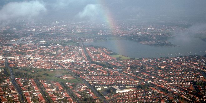 Aerial View of a Rainbow and the City of Sydney, Commonwealth of Australia. Photo Credit: Gary M. Stolz, Washington DC Library, United States Fish and Wildlife Service Digital Library System (http://images.fws.gov, WO8426-002), United States Fish and Wildlife Service (FWS, http://www.fws.gov), United States Department of the Interior (http://www.doi.gov), Government of the United States of America (USA).
