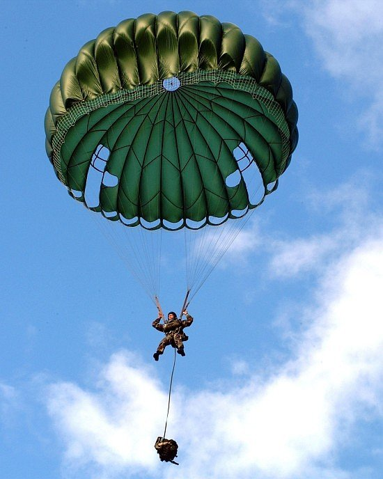 In a U.S. Military Static Line Parachute Jump, the Line Jumper is Temporarily Suspended Midair with the White Clouds in a Beautiful Blue Sky, June 24, 2002. Talofofo, Territory of Guam, USA. Photo Credit: Photographer's Mate 2nd Class Crystal Brooks, Navy NewsStand  Eye on the Fleet Photo Gallery (http://www.news.navy.mil/view_photos.asp, 020124-N-5686B-002), United States Navy (USN, http://www.navy.mil), United States Department of Defense (DoD, http://www.DefenseLink.mil or http://www.dod.gov), Government of the United States of America (USA).