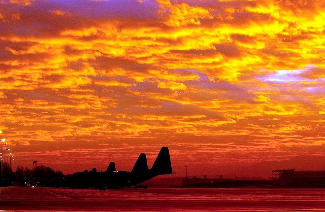 """Stunningly Beautiful Sunrise over Ramstein Air Base. Landes Rheinland-Pfalz (State of Rhineland-Palatinate), Bundesrepublik Deutschland - Federal Republic of German. Photo Credit: Tech. Sgt. Justin D. Pyle, Air Force Link - Week in Photos, December 5, 2003 (http://www.af.mil/weekinphotos/031205-01.html, 031201-F-6701P-001, """"Fire in the sky""""), United States Air Force (USAF, http://www.af.mil), United States Department of Defense (DoD, http://www.DefenseLink.mil or http://www.dod.gov), Government of the United States of America (USA)."""