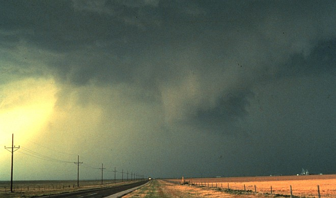 A Lonely Road, Large Dark Clouds, and the Storm Core's Thunderstorm Out Flow Showing Up as Sheets of Wind-Driven Rain Spreading From Right to Left, 1982. Photo Credit: OAR/ERL/National Severe Storms Laboratory (NSSL), National Oceanic and Atmospheric Administration Photo Library (http://www.photolib.noaa.gov, nssl0050), National Severe Storms Laboratory (NSSL) Collection, NOAA Central Library, National Oceanic and Atmospheric Administration (NOAA, http://www.noaa.gov), United States Department of Commerce (http://www.commerce.gov), Government of the United States of America (USA).