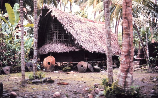 The money stones in front of this home in Yap indicates great wealth. The Yapese money stones were quarried from stalactites in limestone caves on Palau (Beluu er a Belau) and carried by outrigger canoe 300 miles. October 1971. Yap, Federated States of Micronesia. Photo Credit: Dr. James P. McVey, NOAA Sea Grant Program, National Oceanic and Atmospheric Administration Photo Library (http://www.photolib.noaa.gov, mvey0120, October 1971), Small World Collection, NOAA Central Library, National Oceanic and Atmospheric Administration (NOAA, http://www.noaa.gov), United States Department of Commerce (http://www.commerce.gov), Government of the United States of America (USA).