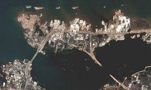 "6. After the Tsunami the Banda Aceh Shore is Gone, DigitalGlobe Satellite Photo, December 28, 2004, Republik Indonesia. Photo Credit: DigitalGlobe (http://DigitalGlobe.com), Tsunami Media Gallery, QuickBird Images of Tsunami Sites (http://DigitalGlobe.com/tsunami_gallery.html), Indonesia, December 28, 2004, ""Banda Aceh Shore"". DigitalGlobe Imagery Analysis: ""Tsunami Aftermath: Banda Aceh, Indonesia; QuickBird Imagery, 28 December, 2004"" <http://DigitalGlobe.com/images/tsunami/Banda_Aceh_Tsunami_Damage.pdf>."