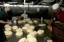 9. Preparing Bread on the USS Abraham Lincoln (CVN 72) For the Suffering Men, Women, and Children in Aceh, Sumatra, Republik Indonesia. January 2, 2005, Indian Ocean. Photo Credit: Photographer's Mate Airman Apprentice Timothy C. Roache Jr., Navy NewsStand - Eye on the Fleet Photo Gallery (http://www.news.navy.mil/view_photos.asp, 050102-N-5837R-011), United States Navy (USN, http://www.navy.mil), United States Department of Defense (DoD, http://www.DefenseLink.mil or http://www.dod.gov), Government of the United States of America (USA).