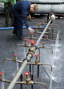 1. Testing the Purified Water Coming From a Potable Water Manifold, January 4, 2005, USS Abraham Lincoln (CVN 72), Indian Ocean. Photo Credit: Photographer's Mate Airman Jordon R. Beesley, Navy NewsStand - Eye on the Fleet Photo Gallery (http://www.news.navy.mil/view_photos.asp, 050104-N-4166B-047), United States Navy (USN, http://www.navy.mil), United States Department of Defense (DoD, http://www.DefenseLink.mil or http://www.dod.gov), Government of the United States of America (USA).