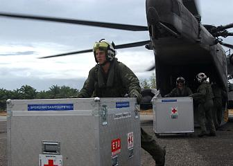 4. Unloading Medical Supplies From a CH-53E Super Stallion Helicopter at Muebaloh City Air Field, January 8, 2005. Meubaloh, Sumatra, Republik Indonesia. Photo Credit: Journalist 3rd Class Ryan Valverde, Navy NewsStand - Eye on the Fleet Photo Gallery (http://www.news.navy.mil/view_photos.asp, 050108-N-4451V-007), United States Navy (USN, http://www.navy.mil), United States Department of Defense (DoD, http://www.DefenseLink.mil or http://www.dod.gov), Government of the United States of America (USA).