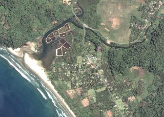 "1. Alive and Thriving: The Village of Gleebruk Before the Tsunami Stuck. DigitalGlobe Satellite Photo, April 12, 2004. Republik Indonesia. Photo Credit: DigitalGlobe (http://DigitalGlobe.com), Tsunami Media Gallery, QuickBird Images of Tsunami Sites (http://DigitalGlobe.com/tsunami_gallery.html), Indonesia, April 12, 2004, ""Gleebruk Village (Before Tsunami)"" ""Village detail before tsunami"". DigitalGlobe Imagery Analysis: ""Tsunami Aftermath: Near Banda Aceh, Indonesia; QuickBird Satellite Imagery, January 2, 2005"" <http://DigitalGlobe.com/images/tsunami/Gleebruk_Tsunami_Damage_Jan2.pdf>."