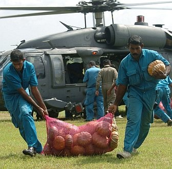 "2. Unloading a bag of vegetables from the United States Air Force HH-60G Pave Hawk helicopter in Sri Lanka, one of the countries devastated by the wall of water caused by ""The Great Earthquake and Catastrophic Tsunami of 2004"" <http://ChamorroBible.org/gpw/gpw-The-Great-Earthquake-and-Catastrophic-Tsunami-of-2004.htm>. January 12, 2005, Dambula, Democratic Socialist Republic of Sri Lanka. Photo Credit: United States Air Force Master Sgt. Val Gempis, DefenseLINK News Photos - Unified Assistance (http://www.DefenseLink.mil/photos/Operations/UnifiedAssistance, January 14, 2005, 050112-F-1740G-005, ""Sri Lankan workers unload bags of vegetables from a U.S. Air Force HH-60 Pavehawk helicopter.""), United States Air Force (USAF, http://www.af.mil), United States Department of Defense (DoD, http://www.DefenseLink.mil or http://www.dod.gov), Government of the United States of America (USA)."