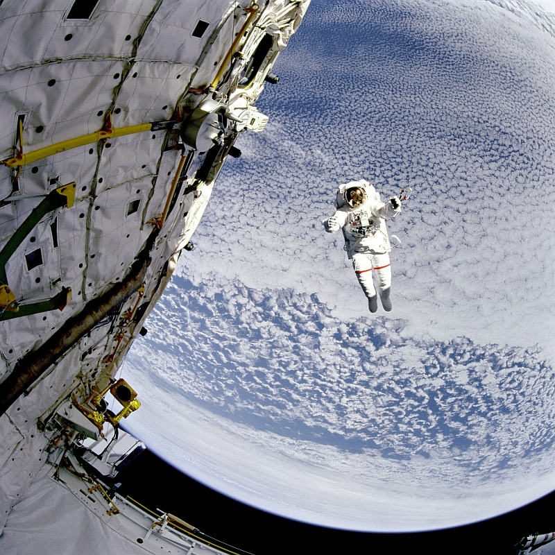 20. NASA Astronaut Mark C. Lee Tests NASA's New Simplified Aid for EVA Rescue (SAFER) System While Floating Untethered High Above Beautiful Blue-and-White Earth, September 16, 1994 at 15:19:42 GMT, South Pacific Ocean As Seen From Space Shuttle Discovery (STS-64), Latitude (LAT): -55.0, Longitude (LON): -99.4, Altitude (ALT): 129 Nautical Miles, Sun Azimuth (AZI): 53 degrees, Sun Elevation Angle (ELEV): 20 degrees. Photo Credit: NASA; Earth, Clouds, Space Shuttle Discovery (STS-64), NASA Astronaut Mark C. Lee, EVA (Extravehicular Activity), GRIN (http://grin.hq.nasa.gov) Database Number: GPN-2000-001040 (STS064-217-008 or STS064-217-8, http://eol.jsc.nasa.gov/scripts/sseop/photo.pl?mission=STS064&roll=217&frame=8), National Aeronautics and Space Administration (NASA, http://www.nasa.gov), Government of the United States of America.
