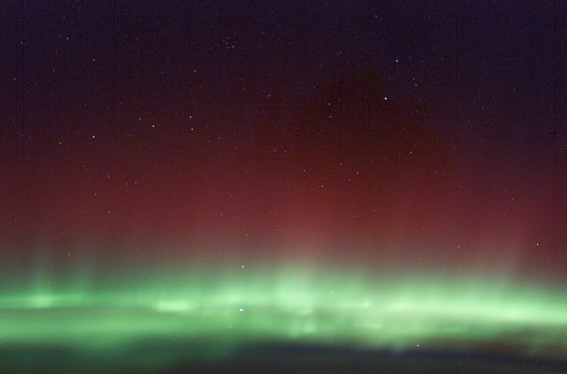 4. Shimmering Red Aurora Borealis and Green Aurora Borealis (Northern Lights), March 30, 2003 As Seen From the International Space Station (Expedition 6). Photo Credit: NASA; ISS006-E-41616, Red and Green Aurora Borealis, Stars, International Space Station (Expedition Six); Image Science and Analysis Laboratory, NASA-Johnson Space Center. 'Astronaut Photography of Earth - Display Record.' <http://eol.jsc.nasa.gov/scripts/sseop/photo.pl?mission=ISS006&roll=E&frame=41616>; National Aeronautics and Space Administration (NASA, http://www.nasa.gov), Government of the United States of America (USA).