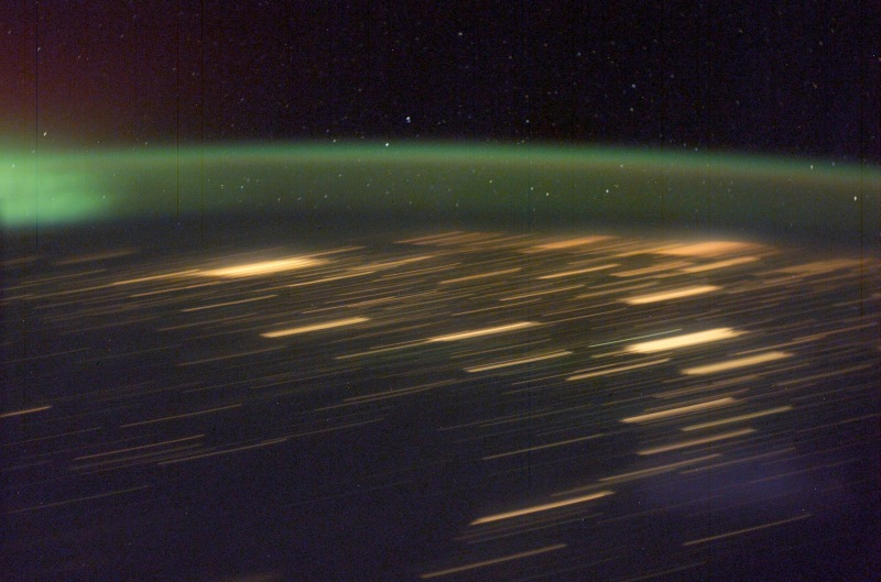 7. Green Aurora Borealis and City Lights at Night, March 30, 2003 As Seen From the International Space Station (Expedition 6). Photo Credit: NASA; ISS006-E-41641, Green Aurora Borealis, City lights, Night, International Space Station (Expedition Six); Image Science and Analysis Laboratory, NASA-Johnson Space Center. 'Astronaut Photography of Earth - Display Record.' <http://eol.jsc.nasa.gov/scripts/sseop/photo.pl?mission=ISS006&roll=E&frame=41641>; National Aeronautics and Space Administration (NASA, http://www.nasa.gov), Government of the United States of America (USA).