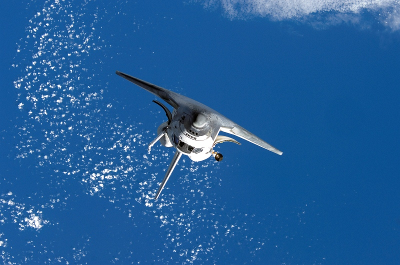 13. Backdropped By White Clouds Over Earth's Blue Waters, Space Shuttle Discovery Approaches the International Space Station, October 25, 2007 As Seen From the International Space Station (Expedition Sixteen). Photo Credit: NASA; STS-120 Shuttle Mission Imagery (http://spaceflight.nasa.gov/gallery/images/shuttle/sts-120/ndxpage1.html): ISS016-E-006333 (http://spaceflight.nasa.gov/gallery/images/shuttle/sts-120/html/iss016e006333.html), NASA Human Space Flight (http://spaceflight.nasa.gov), National Aeronautics and Space Administration (NASA, http://www.nasa.gov), Government of the United States of America.