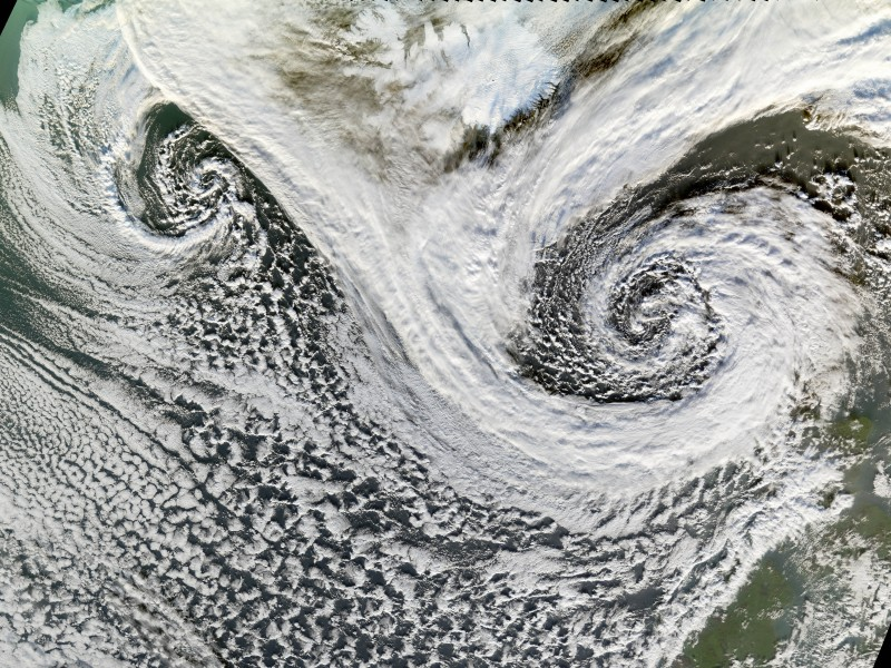 12. Two Spectacular, Swirling Storms -- Dual Cyclones -- In the North Atlantic Ocean Separated By Lydveldid Island - Republic of Iceland, November 20, 2006, As Seen By the MODIS Instrument Aboard NASA's Terra Satellite. Photo Credit: NASA; MODIS (Moderate Resolution Imaging Spectroradiometer) instrument aboard NASA's Terra satellite, Jesse Allen of NASA's Earth Observatory Team, and NASA's Earth Observatory; National Aeronautics and Space Administration (NASA, http://www.nasa.gov), Government of the United States of America (USA).