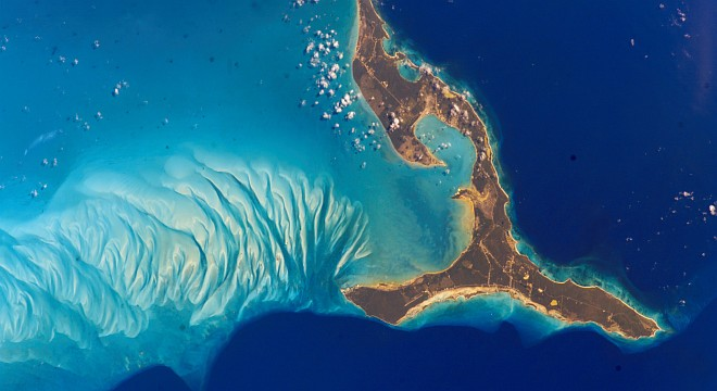 Eleuthera (also Eleuthera Island), Commonwealth of The Bahamas (at right). Photo Credit: International Space Station Image Date: March 16, 2002, South end of the island of Eleuthera, The Bahamas; NASA-Johnson Space Center. 15 December 2004. 'Astronaut Photography of Earth - Display Record.' <http://eol.jsc.nasa.gov/scripts/sseop/photo.pl?mission=ISS004&roll=E&frame=8777>; National Aeronautics and Space Administration (NASA, http://www.nasa.gov), Government of the United States of America (USA). The photo's full size request URL is <http://eol.jsc.nasa.gov/scripts/sseop/LargeImageAccess.pl?directory=ESC/large/ISS004&filename=ISS004-E-8777.JPG&filesize=985764>