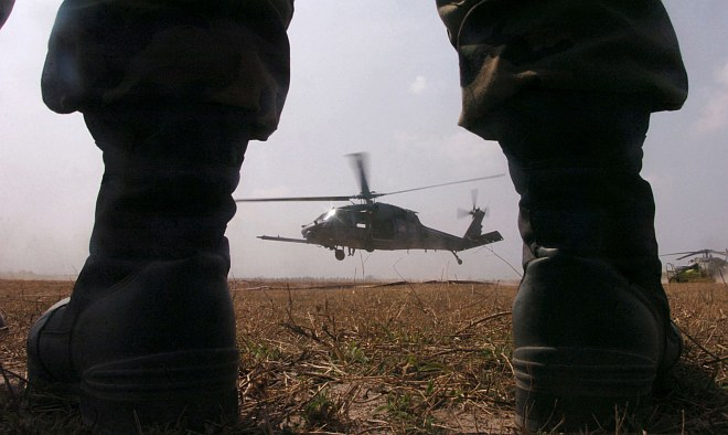 """Both Feet Firmly Planted on the Ground, January 18, 2005. Dambula, Democratic Socialist Republic of Sri Lanka. Photo Credit: Master Sgt. Val Gempis, Air Force Link - News (http://www.af.mil/news, January 27, 2005, """"Boots on the ground"""", Image ID: 050118-F-1740G-004), United States Air Force (USAF, http://www.af.mil), United States Department of Defense (DoD, http://www.DefenseLink.mil or http://www.dod.gov), Government of the United States of America (USA)."""
