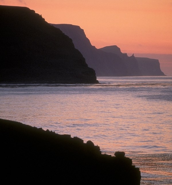 Beautiful Sunset With the Fading Orange Sunlight Reflecting Off the Bearing Sea and Sky. High Bluffs, St. George, Pribilof Islands, State of Alaska, USA. Photo Credit: Dean Kildaw, Alaska Image Library, United States Fish and Wildlife Service Digital Library System (http://images.fws.gov, AMNWR/0003246/Kildaw D), United States Fish and Wildlife Service (FWS, http://www.fws.gov), United States Department of the Interior (http://www.doi.gov), Government of the United States of America (USA).