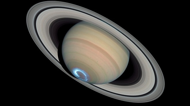 A Grand Scene - Majestic Saturn, Its Stunning Rings, and Beautiful Blue Aurora at the Southern Pole. Photo Credit: Saturn's Dynamic Auroras, January 28, 2004 (ultraviolet image of the aurora) and March 22, 2004 (visible-light image of the planet and rings), STScI-2005-06 (February 16, 2005), NASA's Earth-orbiting Hubble Space Telescope (http://HubbleSite.org); European Space Agency (ESA, http://SpaceTelescope.org), John Clarke (University of Michigan), Z. Levay (STScI), Erich Karkoschka (University of Arizona), National Aeronautics and Space Administration (NASA, http://www.nasa.gov), Government of the United States of America (USA). Acknowledgment: Ray A. Lucas (STScI/AURA).