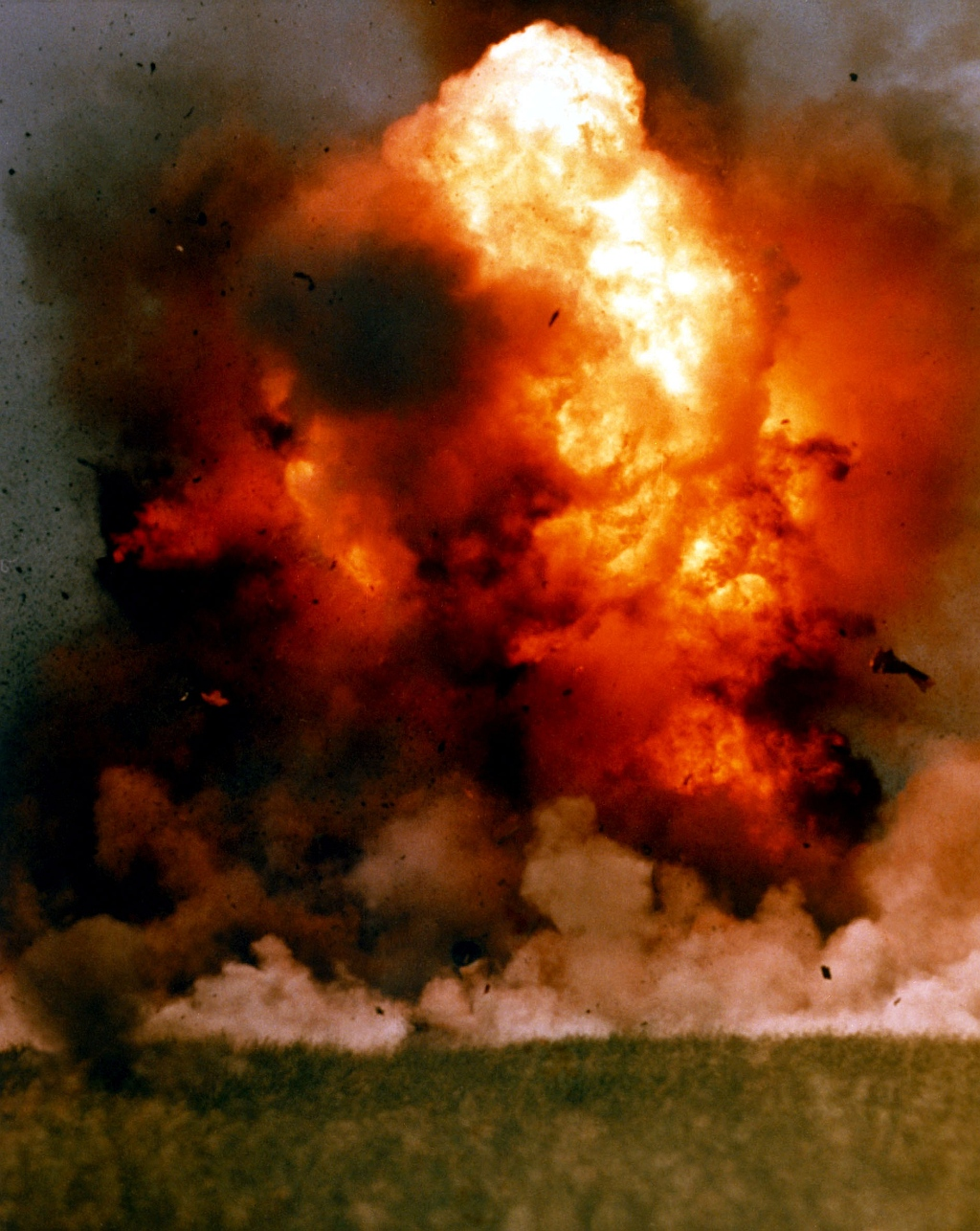 6c. The explosion destroys the target, the revetted aircraft, April 1, 1986, San Clemente Island, State of California, USA. Photo Credit: Defense Visual Information Center (DVIC, http://www.DoDMedia.osd.mil, DN-SC-86-06114) and United States Navy (USN, http://www.navy.mil), United States Department of Defense (DoD, http://www.DefenseLink.mil or http://www.dod.gov), Government of the United States of America (USA).