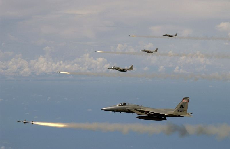 7. Four F-15 Eagle Fighter Jets, Assigned to the Missouri Air National Guard 110th Fighter Squadron, Simultaneously Fire AIM-7 Sparrow Radar-Guided Air-to-Air Missiles At a Target Drone During the U.S. Air Force's Weapons System Evaluation Program (WSEP) known as 'Combat Archer', July 15, 2005, Gulf of Mexico, USA. Photo Credit: Master Sgt. Michael Ammons, United States Air Force; Defense Visual Information (DVI, http://www.DefenseImagery.mil, 050715-F-7709A-003 and DF-SD-08-03403) and United States Air Force (USAF, http://www.af.mil), United States Department of Defense (DoD, http://www.DefenseLink.mil or http://www.dod.gov), Government of the United States of America (USA).