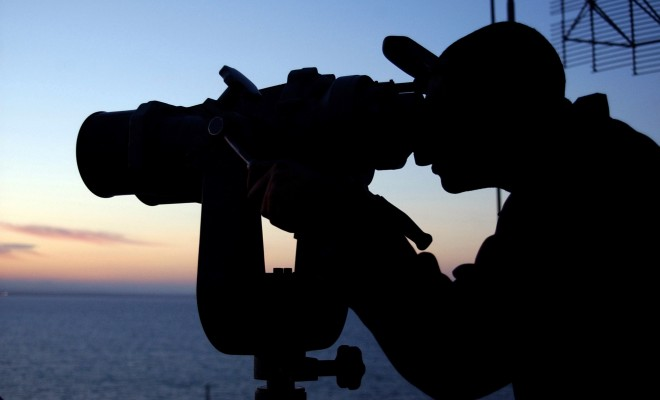 Watching With High-Powered Binoculars Aboard the United States Navy Aircraft Carrier USS Harry S. Truman (CVN 75), March 26, 2005. Suez Canal, Jumhuriyat Misr al-Arabiyah - Arab Republic of Egypt. Photo Credit: Photographer's Mate 3rd Class Nichole E. Wozny, Navy NewsStand - Eye on the Fleet Photo Gallery (http://www.news.navy.mil/view_photos.asp, 050326-N-3665W-018), United States Navy (USN, http://www.navy.mil), United States Department of Defense (DoD, http://www.DefenseLink.mil or http://www.dod.gov), Government of the United States of America (USA).