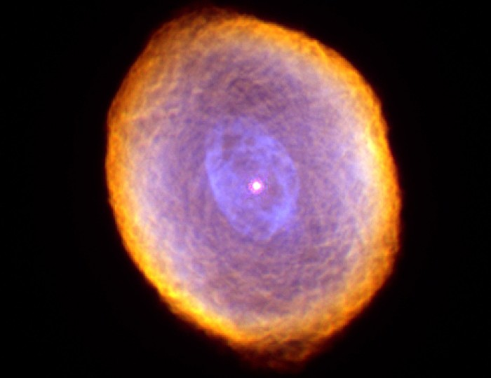 The Spirograph Nebula, IC 418, shown in false-color is about 2,000 light-years from earth towards the constellation Lepus. The white circle at the center is the star, red is ionized nitrogen (the coolest gas), green is hydrogen, and the color blue is ionized oxygen (the hottest gas). Photo Credit: IC 418: The 'Spirograph' Nebula, February and September, 1999 (Released: September 7, 2000), STScI-2000-28, NASA's Earth-orbiting Hubble Space Telescope (http://HubbleSite.org); The Hubble Heritage Team (STScI/AURA), National Aeronautics and Space Administration (NASA, http://www.nasa.gov), Government of the United States of America (USA). Acknowledgment: Dr. Raghvendra Sahai (JPL) and Dr. Arsen R. Hajian (USNO).