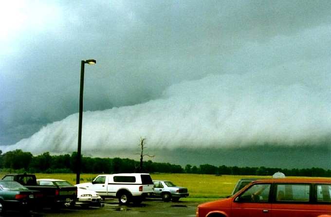 The Shelf Cloud Approaches the Sterling National Weather Service Forecast Office, June 18, 1997. Sterling, Commonwealth of Virginia, USA. Photo Credit: National Weather Service Forecast Office Washington, D.C.; National Oceanic and Atmospheric Administration Photo Library (http://www.photolib.noaa.gov, noaa6122), NOAA's Online World Collection, National Oceanic and Atmospheric Administration (NOAA, http://www.noaa.gov), United States Department of Commerce (http://www.commerce.gov), Government of the United States of America (USA).
