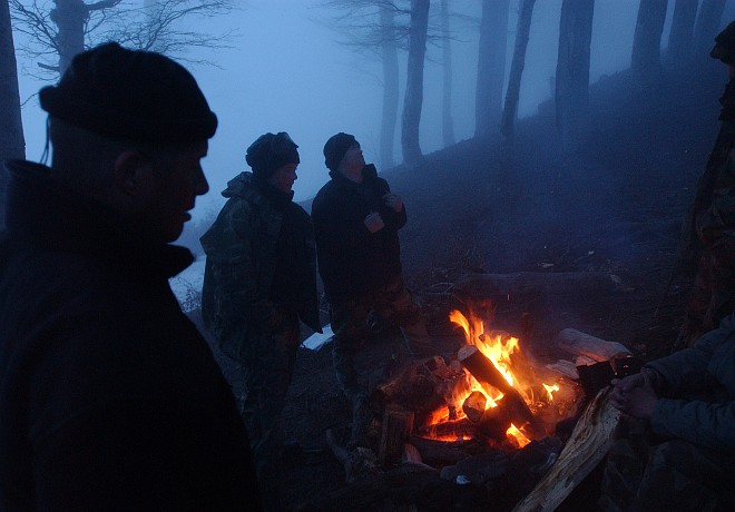 """Dense Fog and a Welcome Campfire at Camp Talon Pride in the Albanian Mountains, April 12, 2005. Qarku i Tiranes, Republika e Shqiperise - Republic of Albania. Photo Credit: Staff Sgt. Michael R. Holzworth, Air Force Link - Week in Photos, April 22, 2005 (http://www.af.mil/weekinphotos/050422-02.html, 050412-F-3431H-052, """"Fire and fog""""), United States Air Force (USAF, http://www.af.mil), United States Department of Defense (DoD, http://www.DefenseLink.mil or http://www.dod.gov), Government of the United States of America (USA)."""