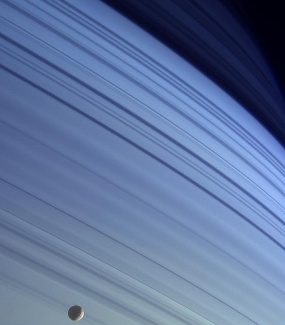 Beautiful True Color View of Saturn's Blue Skies in the Northern Hemisphere, Saturn's Moon Mimas (foreground), and Shadows of the Planet's Majestic Rings Visible As Long, Dark Lines On the Atmosphere. Photo Credit: Cassini-Huygens Mission (http://saturn.jpl.nasa.gov), Cassini Orbiter, January 18, 2005; Planetary Photojournal (http://photojournal.jpl.nasa.gov, PIA06176), National Aeronautics and Space Administration (NASA, http://www.nasa.gov)/Jet Propulsion Laboratory (JPL, http://www.jpl.nasa.gov)/Space Science Institute (http://ciclops.org), Government of the United States of America. See also Science@NASA: Blue Skies on Saturn <http://science.nasa.gov/headlines/y2005/17feb_bluesaturn.htm> by Dr. Tony Phillips, February 17, 2005.