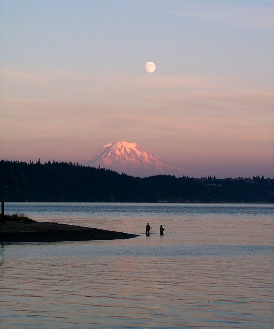 An August 2000 Sunset and Full Moonrise, Snow-Capped Mount Rainier (background), and Peaceful Waters at Gig Harbor, State of Washington, USA. Photo Credit: Carol Baldwin, NOAA OMAO; National Oceanic and Atmospheric Administration Photo Library (http://www.photolib.noaa.gov, line1909), America's Coastlines Collection, National Oceanic and Atmospheric Administration (NOAA, http://www.noaa.gov), United States Department of Commerce (http://www.commerce.gov), Government of the United States of America (USA).