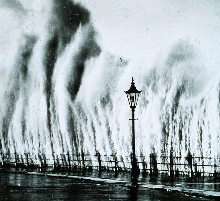 As Waves Smash Into This New England Coastal Seawall in 1938, They Have the Appearance of a Curtain-of-Water or the Simultaneous Eruption of Many Geysers. Photo Credit: NOAA Central Library, National Oceanic and Atmospheric Administration Photo Library (http://www.photolib.noaa.gov, wea00412), Historic NWS Collection, National Oceanic and Atmospheric Administration (NOAA, http://www.noaa.gov), United States Department of Commerce (http://www.commerce.gov), Government of the United States of America (USA).